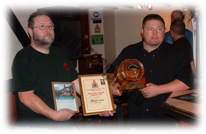 Blacklion's landlord Jason being presented with the trophy